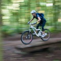 A biker zooming over one of many boardwalks.- Duthie Hill Park