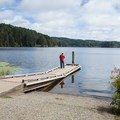The smaller of two boat ramps on Tahkenitch Lake is part of the Tahkenitch Landing Campground, and is much better suited for personal watercraft.- Tahkenitch Lake