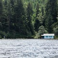 The lake has several private houses floating in the various bays and fingers.- Tahkenitch Lake