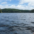 The paddle from Tahkenitch Landing Campground around Jewitt Island is a quick way to get a sense of the lake's size and scenery.- Tahkenitch Lake