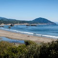 The beach at Battle Rock Park with Humbug Mountain in the distance.- Battle Rock Park