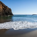 The small beach just north of Battle Rock is a great spot for families.- Battle Rock Park