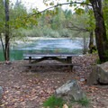 Picnic table by the river.- Big Eddy Park