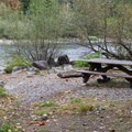 Table at the water in Big Eddy Park.- Big Eddy Park