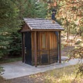 The campground's vault toilet.- Slide Creek Horse Camp