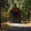 One of multiple vault toilets in the campground.- Dixie Campground