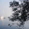 A sailboat off the coast of the island.- James Island Sea Kayaking