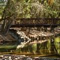 Bridge crossing to more picnic sites.- Anderson Lake County Park