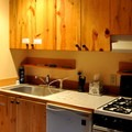 Kitchen and bathroom area in a mix-gendered bunk room.- North Cascades Mountain Hostel