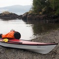 A kayaker takes a break at the Cascadia Marine Trail campsite on Burrows Island.- Burrows Island Sea Kayaking
