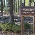 Trailhead signage to Cascade Falls. - Cascade Falls via Bayview Trail