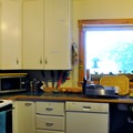 Shared kitchen inside the main hostel.- North Cascades Mountain Hostel