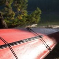 A kayak rests at camp in Reid Harbor.- Stuart Island Sea Kayaking