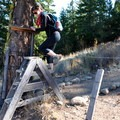The trail leads over a barbed wire fence via stepladder.- Patterson Mountain