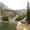 Colchuck Lake's side lake and autumn colors.- Enchantment Lakes Hike via Colchuck Lake
