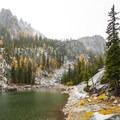 Colchuck Lake's side lake and autumn colors.- Enchantment Lakes Hike via Colchuck Lake