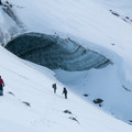 The entrance to Snow Dragon, one of the three caves making up the Sandy Glacier Caves network.- Mount Hood Wilderness