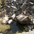 Crossing over Mountaineers Creek.- Colchuck Lake Trail