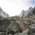 Looking up at the pass between Dragontail and Colchuck Peak.- Colchuck Lake Trail