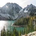 Colchuck Lake with Dragontail Peak (8,840', center) and Colchuck Peak (8,705', right).- Colchuck Lake Trail