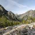 Looking into the Lake Stuart Valley from the Colchuck Lake Trail.- Colchuck Lake Trail