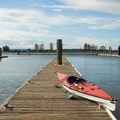 A kayak rests on the dock at the public boat launch in Everett.- Jetty Island Sea Kayaking