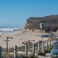 Parking for Scott Creek Beach is alongside of Highway 1.- Scott Creek Beach
