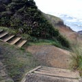 Stairs leading down to the tide pools and sandy beach.- Strawberry Hill