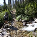 Above the Flytrip Basin, the trail makes many switchbacks to gain elevation and cross the fledgling Middle Fork of the Boise River a time or two.- Middle Fork of the Boise River, Spangle Lake/Divide + Ingleborg Lake/Divide