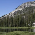 Looking downcanyon across Timpa Lake.- Middle Fork of the Boise River, Rock Creek Canyon and Timpa Lake