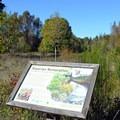 Interpretive sign along the trail. - Elijah Bristow State Park