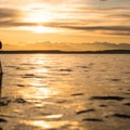 The sun sets over the Olympic Mountains - Elliott Bay Sea Kayaking