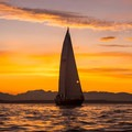 A sailboat silhouetted by the setting sun.- Elliott Bay Sea Kayaking