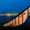 Seattle glows in the background during the landing at Seacrest Park beach.- Elliott Bay Sea Kayaking