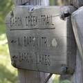 Trail sign at the junction of the South Fork of the Payette Trail and Baron Creek Trail.- Baron Falls + Baron Lakes
