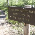 Trail sign at the South Fork of the Payette Trail and Trail Lakes junction.- Baron Falls + Baron Lakes