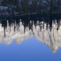 Baron Spire reflected in Upper Baron Lake.- Baron Falls + Baron Lakes