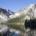 The Monte Verita spires reflected in Upper Baron Lake.- Baron Falls + Baron Lakes