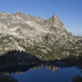 Baron Spire (center) anchors a long ridgeline of beautiful granite towers above Upper Baron Lake.- Baron Falls + Baron Lakes