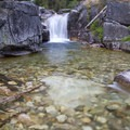 Queens River Falls from the creekbed.  There are easy 5 to 10-foot cliff jumps into the pool at the base of the falls.- Queens River Trailhead to Queens River Falls + Nanny Creek