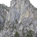 The south buttress of Nahneke Mountain flanks the north side of the trail.  Numerous granite spires like this one beckon technical rock climbers.  Though the rock quality is dubious, there are bound to be some potential routes for exploratory climbers.- Queens River Trailhead to Queens River Falls + Nanny Creek