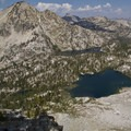 Mount Everly, Everly Lake, Plummer Lake (foreground) and the Rakers (distant spires) from the west shoulder of Plummer Peak.- South Fork of the Payette River, Everly Lake, Plummer Lake + Everly Divide