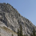 The southwest face of Mount Everly is composed of large granite walls and slabs.- Queens River, Lake 8,696 + Queens River Divide