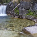 Queens River Falls is accessible by a long day hike up Queens River from the Atlanta area. It can be found by exploring off the trail about a half mile before the Nanny Creek crossing.- Queens River, Lake 8,696 + Queens River Divide