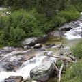The falls and cascades in Queens River can often be heard from the trail, though enjoying the sights often requires a little off-trail hunting to get a nice view of the creek.- Queens River, Lake 8,696 + Queens River Divide