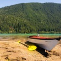 Taking a break on a beach. Anderson Butte (5,720') in the background.- Baker Lake Sea Kayaking