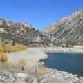 Continuing north along Lake Sabrina's western shoreline.- Lake Sabrina Loop Hike