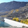 After departing the Sabrina Basin Trailhead on the loop trail, the dam becomes visible to the east.- Lake Sabrina Loop Hike