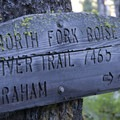 An old and weather trail sign at the junction with the Picket Mountain Trail.- Picket Mountain Trail