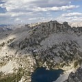 The Rakers just over the top of Blacknose Mountain and Arrowhead Lake. This view is from the summit of Anderson Peak.- Pats Lake, Arrowhead Lake, + Queens River Divide